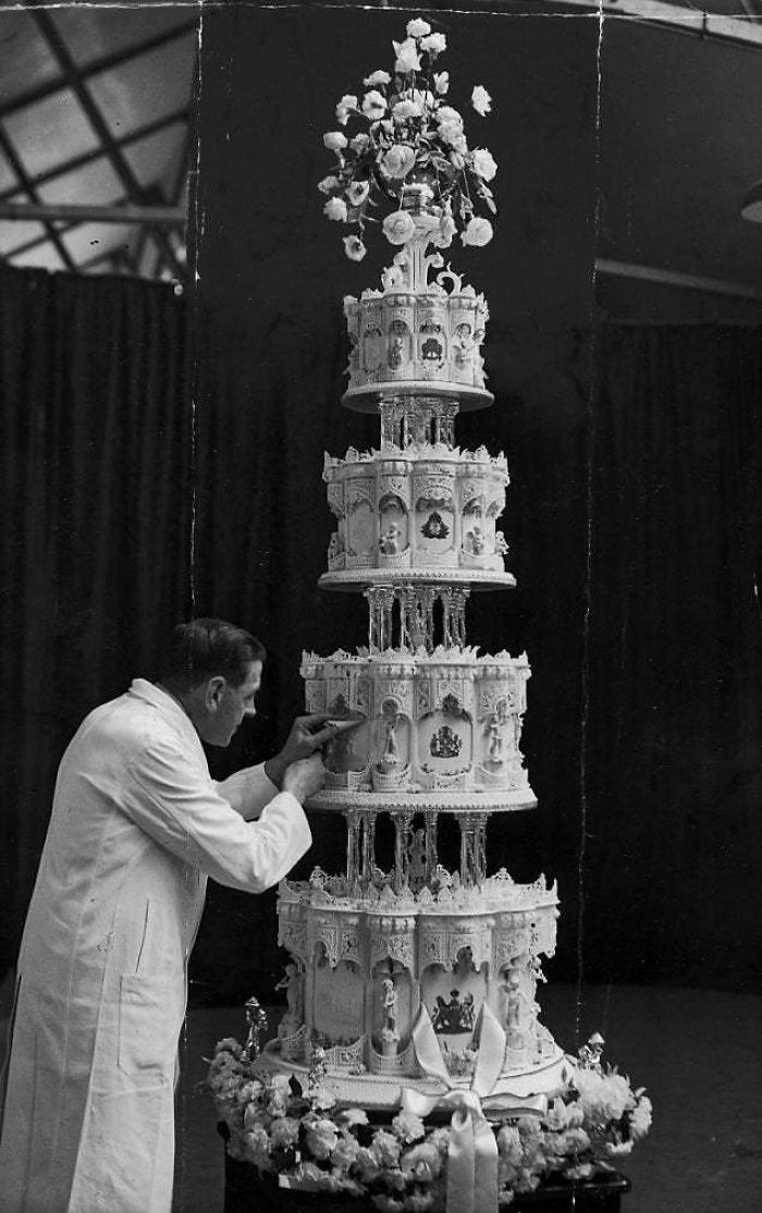 "Queen Elizabeth II's Wedding Cake, 1947. Dubbed ""The 10,000 Mile Wedding Cake"" After Its Ingredients Were Flown In From Australia And South Africa, The Cake Measured 9 Ft In Height And Weighed 500 Lbs"