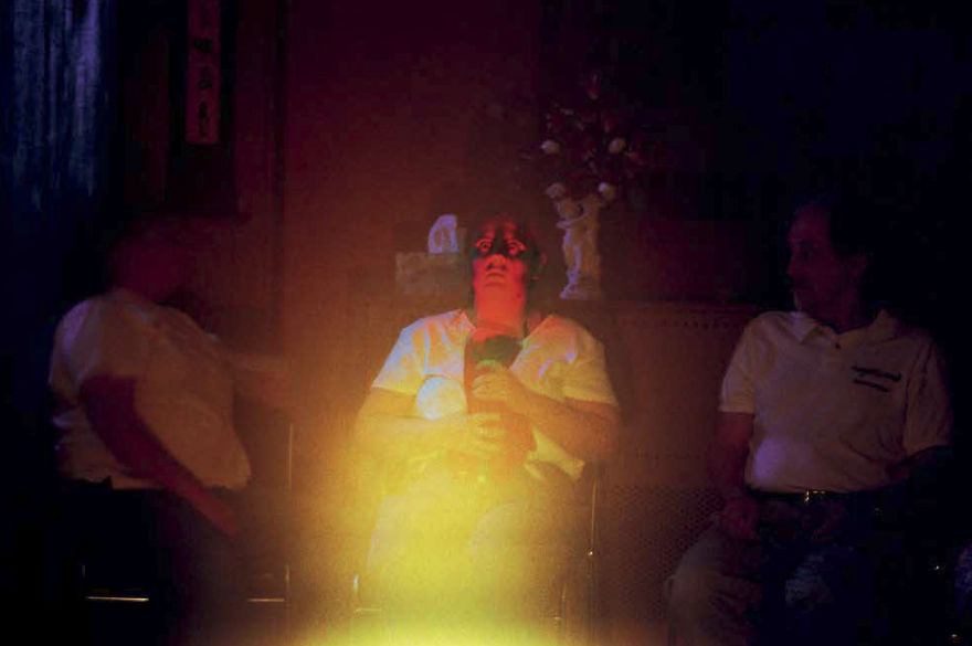 """Shannon Taggart """"Flashlight Experiment"""" (Raymond Buckland Seated At Right). Lily Dale, NY, 2003"""