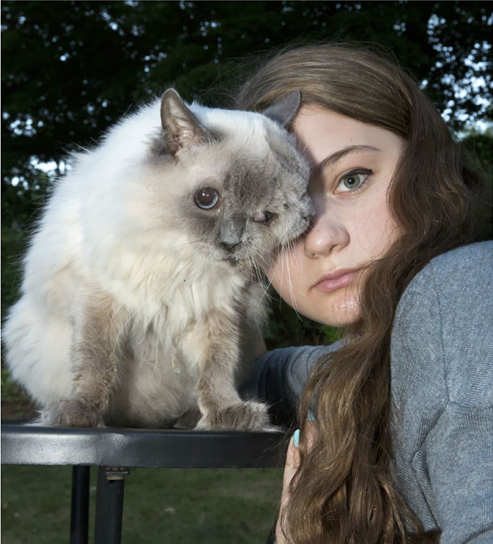 Amelia And Her Two Faced Cat