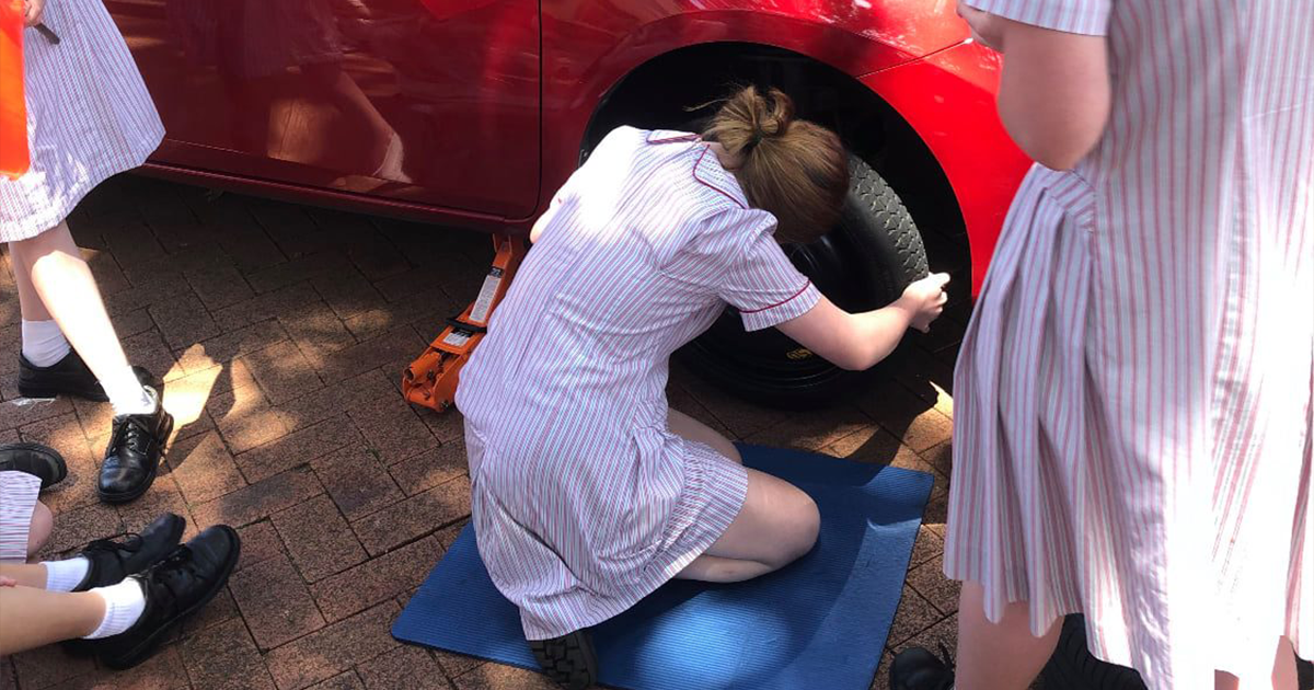 Year 11 Students Learn How To Change Tires And Other Car Maintenance Skills In This Sydney School