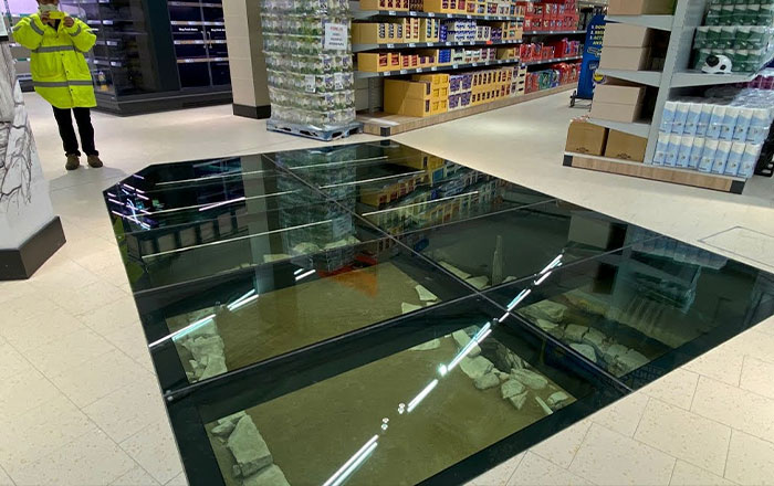 Dublin Grocery Store Installs Glass Floor So People Can See The 11th Century House Below