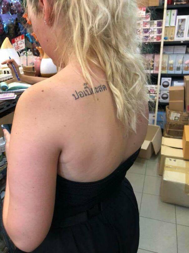 "Her Tattoo Says ""Fresh Spring Rolls"" In Thai"