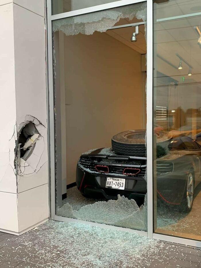 Mclaren Inside A Dealership Gets Hit By A Loose Truck Wheel