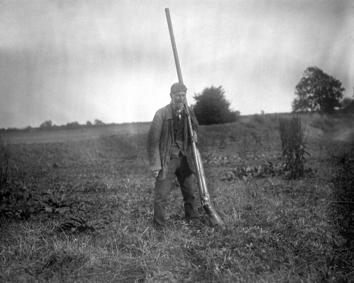 A Man With A Punt Gun, A Type Of Large Shotgun Used For Duck Hunting. It Could Kill Over 50 Birds At Once And Was Banned In The Late 1860s
