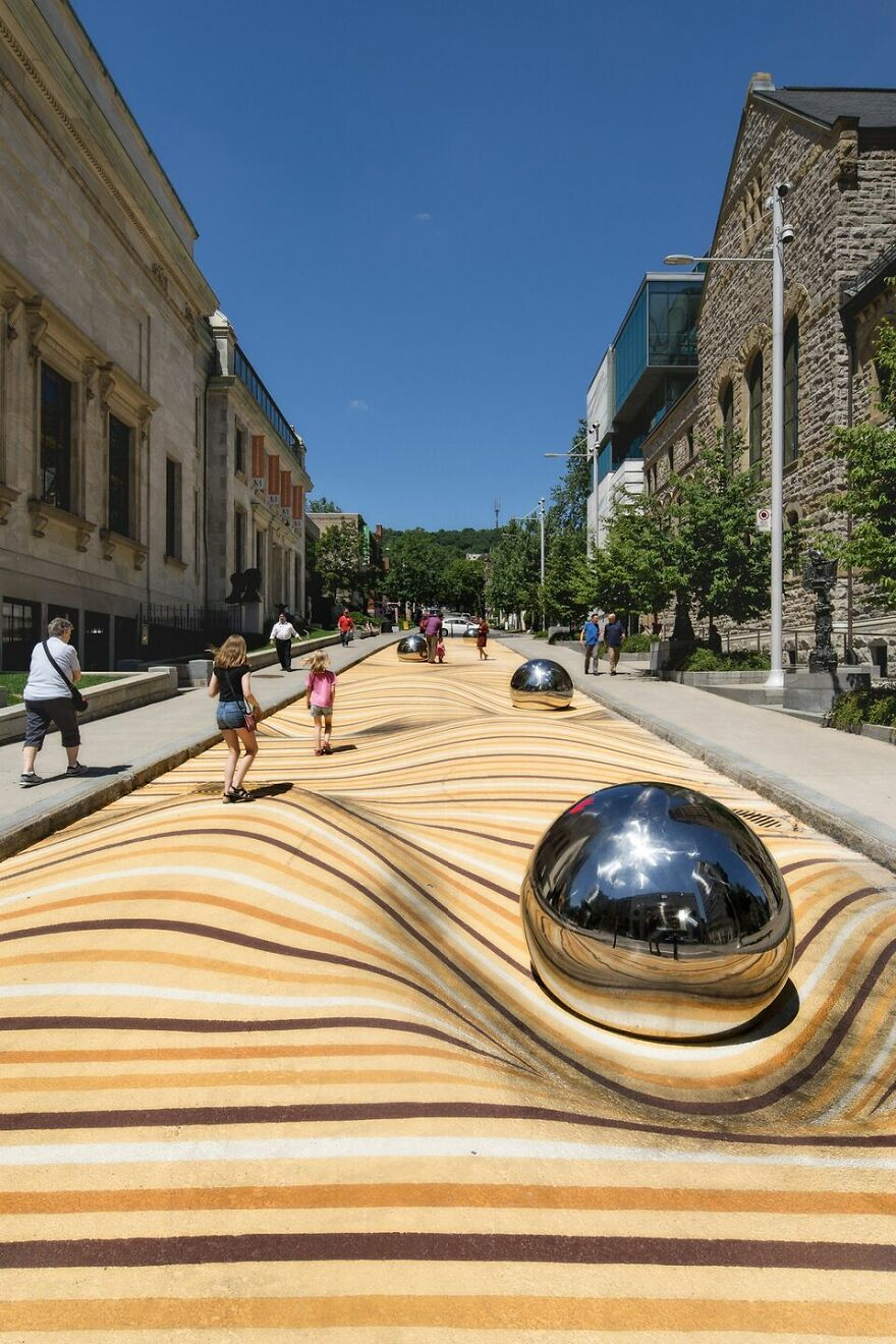 """Artist """"Fills"""" The Street With Sand For A Moving Dunes Mural"""