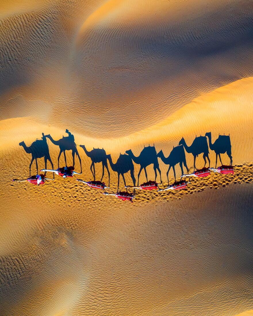 Taking A Camel Ride Through The Desert At Sunset