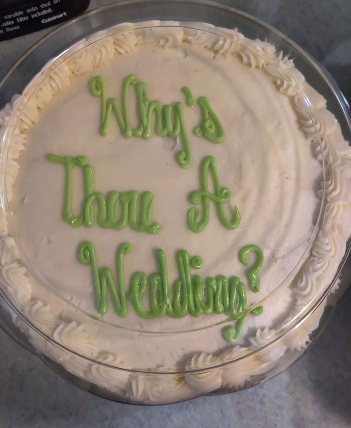 """This Cake Was Supposed To Spell """"Wiser Wedding"""""""