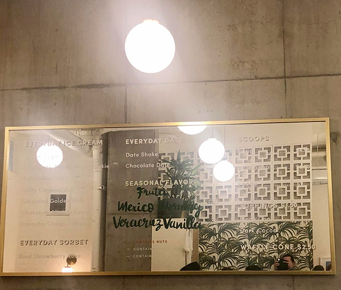 This Busy Ice Cream Shop In Seattle Put Their Menu On A Mirror So It's Impossible To Read