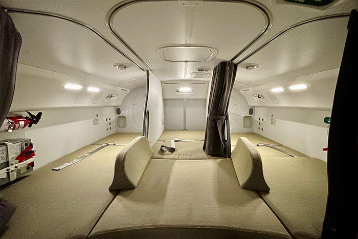 """Here's What It's Like Inside Your Plane's Hidden """"Crew Rest,"""" Where Pilots And Flight Attendants Sleep"""