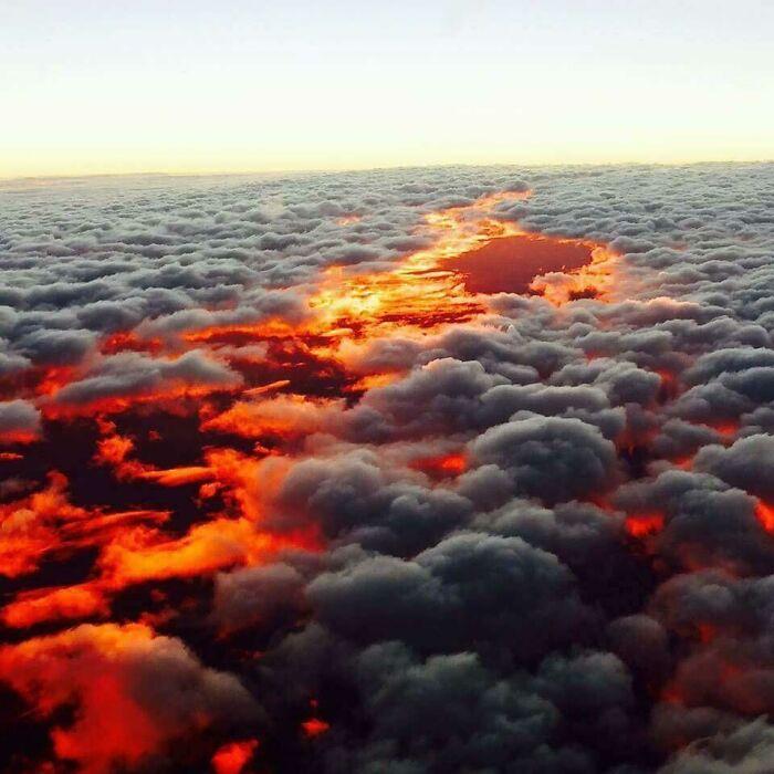 Molten Lava As It Flows Through Rocks