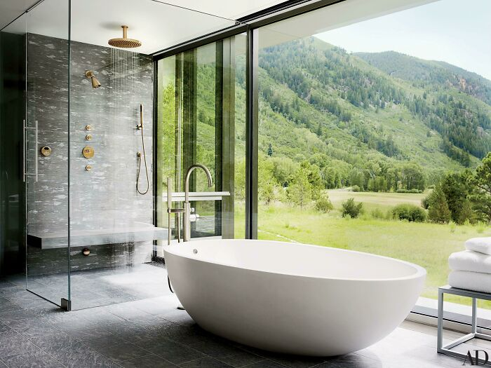 A Large Shower And Bathtub With Mountain Views In Aspen, Co