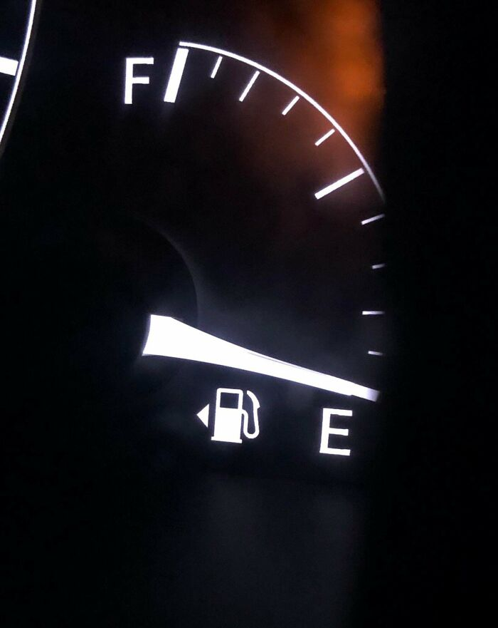 A Little Arrow Next To The Gas Icon On A Car's Dashboard