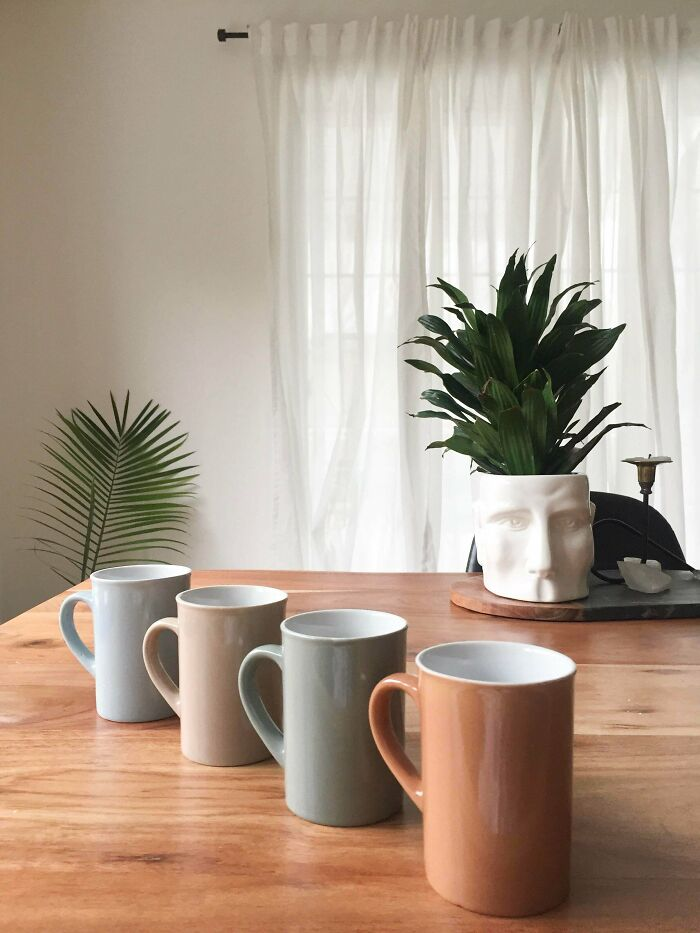 Mugs In Soft Muted Colours For $0.25 A Piece