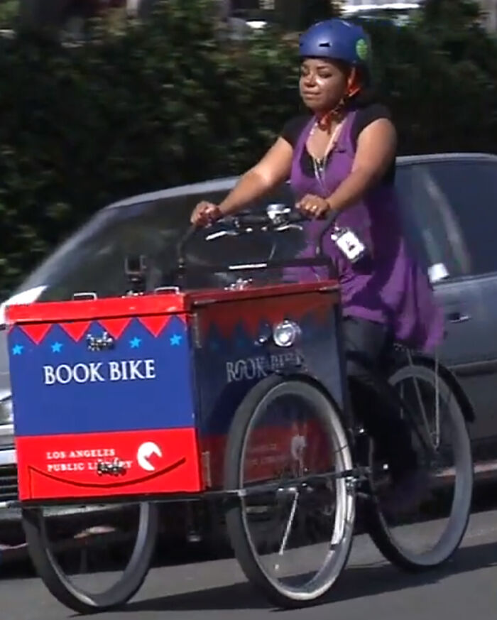 When It's A Pandemic And This San Pedro Librarian Pedals With Books On A Mission To Gather Young Readers