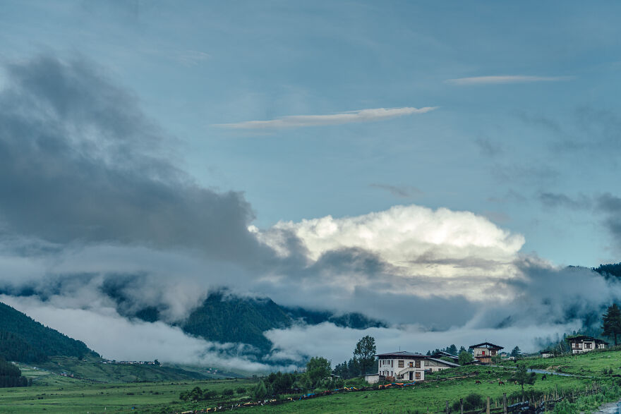 """I Love To Look At The Sky When I Travel. In Particular, The Clouds In Bhutan Leave A Deep Impression On Me. In One Of My Favorite Anime Movies, The Huge Clouds Are Called """"Dragon's Nest,"""" And I Can't Help But Wonder If There Are Dragons Lurking Behind The Clouds In Bhutan. I Can't Help But Think So."""