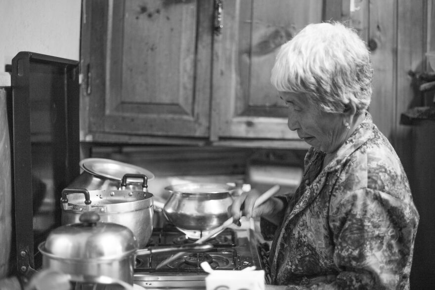 The Appearance Of An Elderly Woman Standing In The Kitchen.
