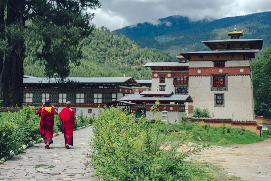 Tibetan Buddhism Has Been Deeply Rooted In Bhutan Since Long Ago. Tibetan Buddhist Monks Clad In Red Robes Can Be Seen Everywhere.