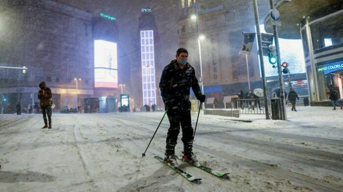 Man Skiing In Madrid During Rare Snowfall In Spain