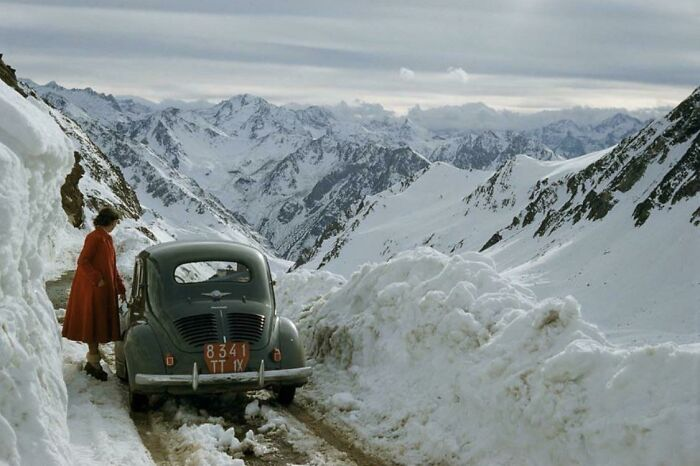 A Woman Overlooking A Snowy Mountain Pass In The Pyrenees Mountains, France - 1956