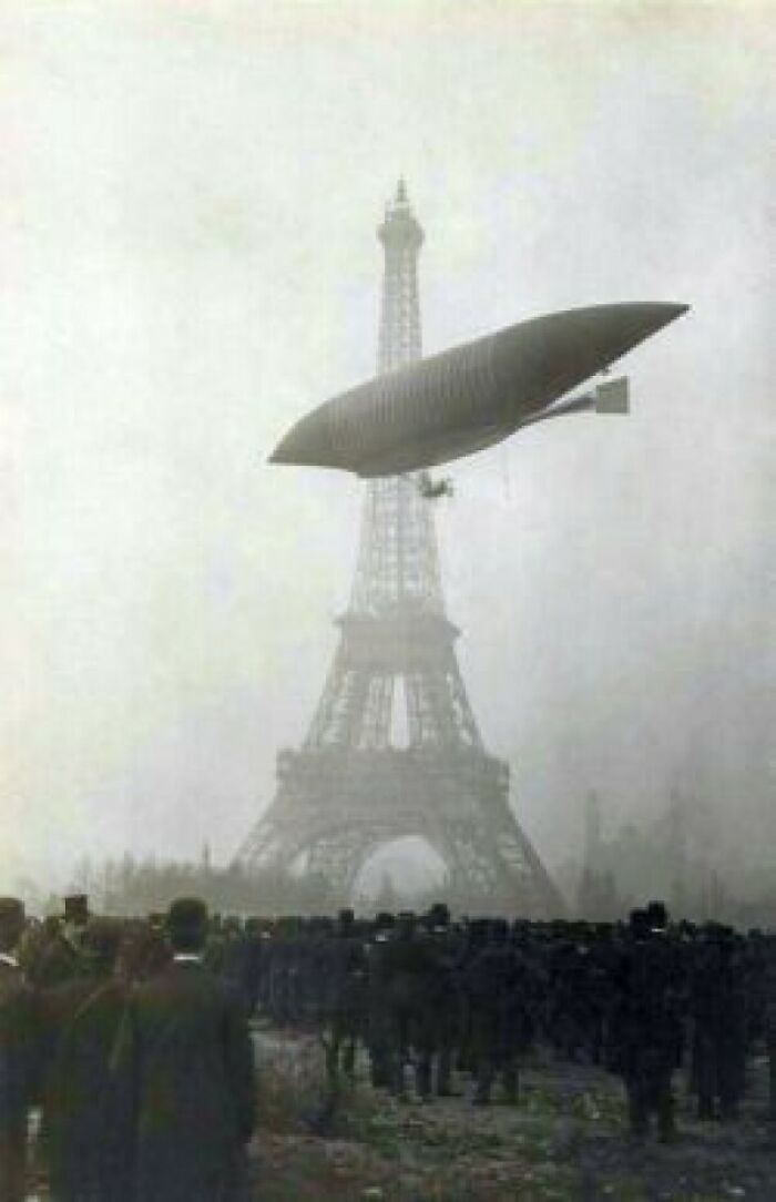 The Airship Le Jaune Flying Past The Eiffel Tower, In Paris, France. (11/20/1903)