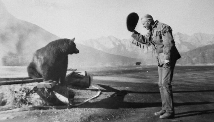Conrad O'brien-Ffrench Greets A Bear. Having Spent His Youth As A Mountie, Surviving The First World War And Serving As An Mi6 Agent In The Second World War, He Was Known To Welcome Danger. Banff National Park, 1950. Photo Taken By Rosalie French