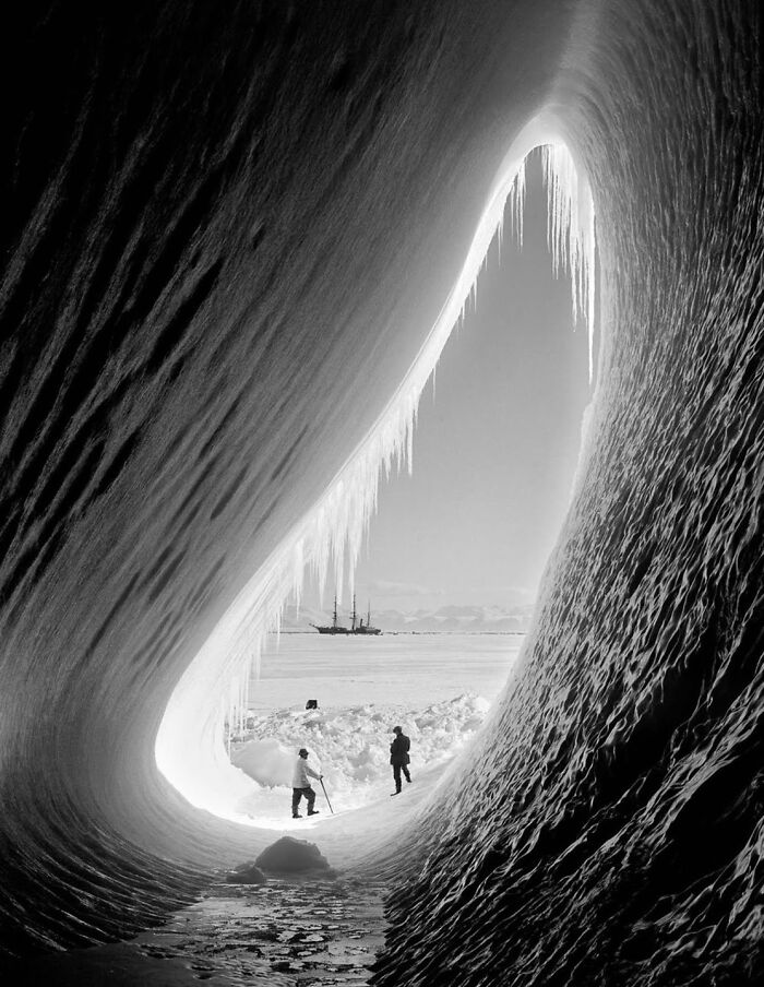Geologist Thomas Griffith Taylor And Meteorologist Charles Wright In The Entrance Of An Ice Grotto. Terra Nova Expedition, Ross Island, 5 January 1911. Photo Taken By Herbert Ponting