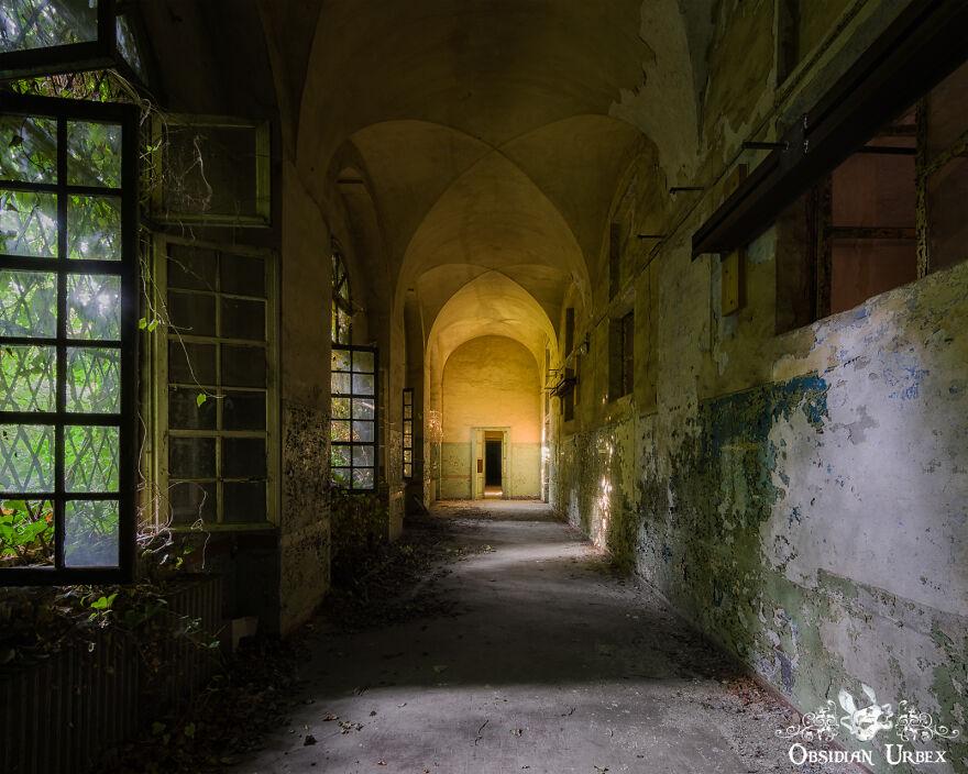 A Dark And Foreboding Corridor Of A Decaying Mental Asylum