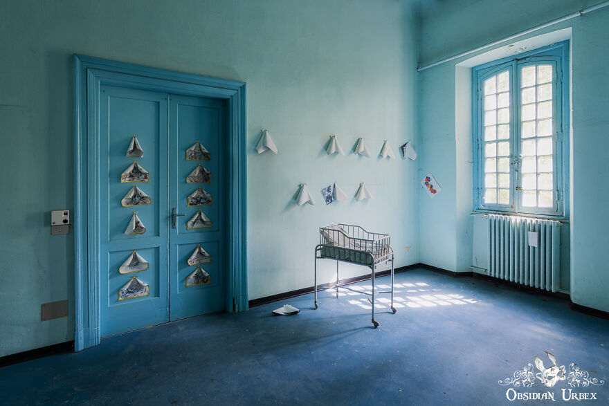 A Lonely Baby Cot, Inside A Maternity Ward Of A Former Asylum
