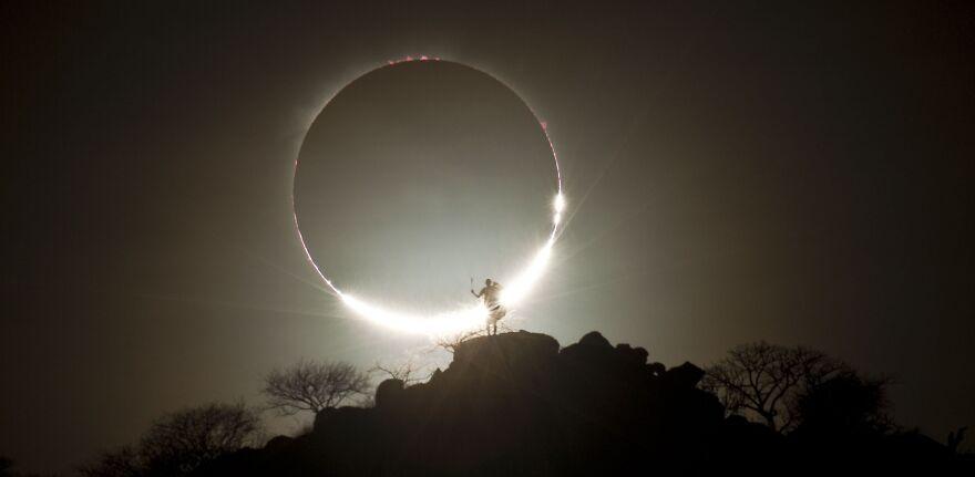 Hybrid Solar Eclipse And Maasai Warrior