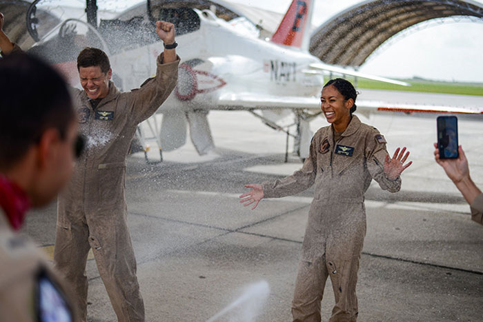 Pilot Celebrates At Her Graduation As The First Black Female Tactical Jet Pilot In US Navy History