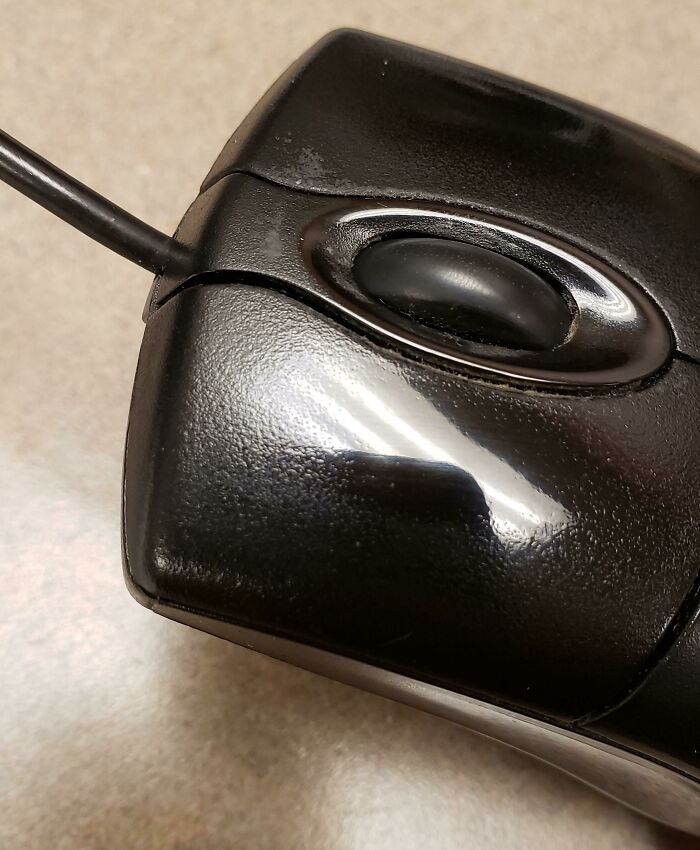 An Office Computer Mouse That's Been Clicked To A Mirror Finish