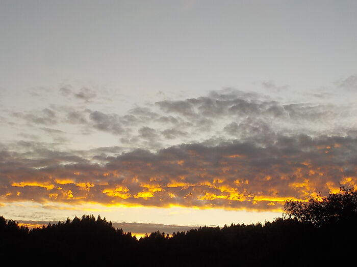 A Sunset Photo That Looks Like The Clouds Are On Fire