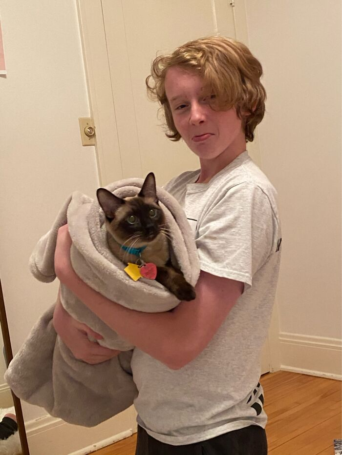 Here's My Brother With Our Cat Rizzo. We Turned Him Into A Burrito.