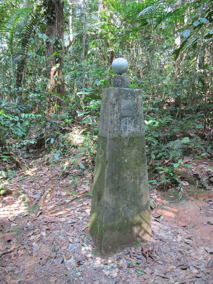 While Hiking An Isolated Jungle Trail In The Amazon, We Came Across This Post Marking The Equator.