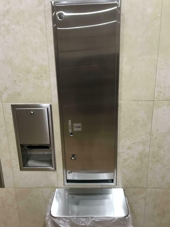 Diaper Dispenser For Men With Babies In A Walmart's Men's Restroom
