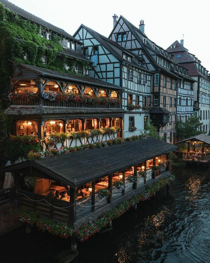 Restaurant On The River Ill Flowing Through The Historic Petite France Quarter Of Strasbourg, France