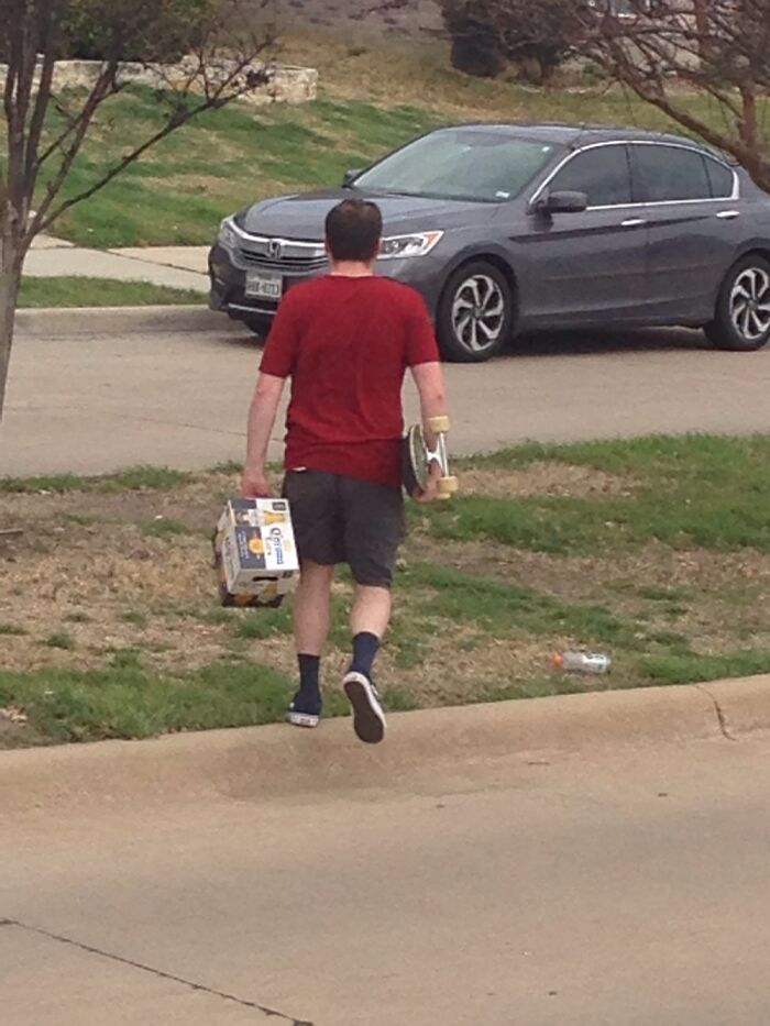 This Man Skateboarding Back From The The Store With A Whole Pack Of Beer