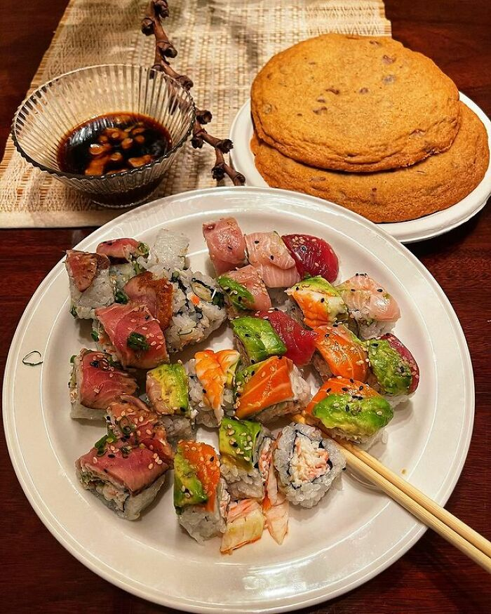 A Variety Of Sushi And Extremely Large Chocolate Chip Cookies