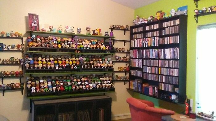 Collection Of Funko Pops And A Barbie Dressed As Ziggy Stardust