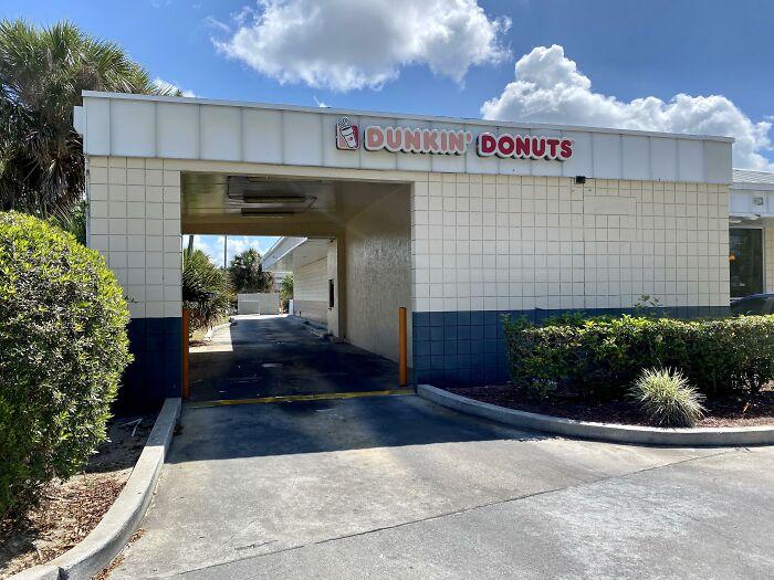 Dunkin' Doughnuts Drive Thru In A Former Gas Station Car Wash.