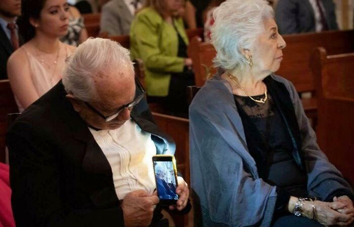An Old Man Taking Pictures Of His Wife Without Her Realizing