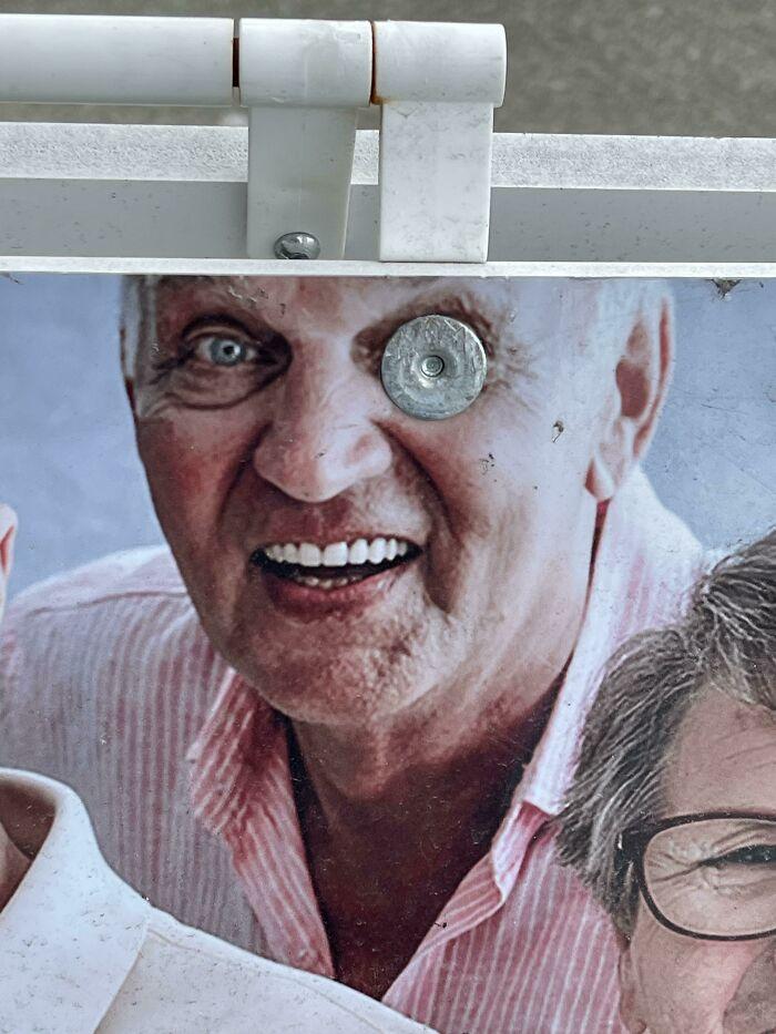 Sandwich Board Advertising Seniors Day - Unfortunate Fastener Placement