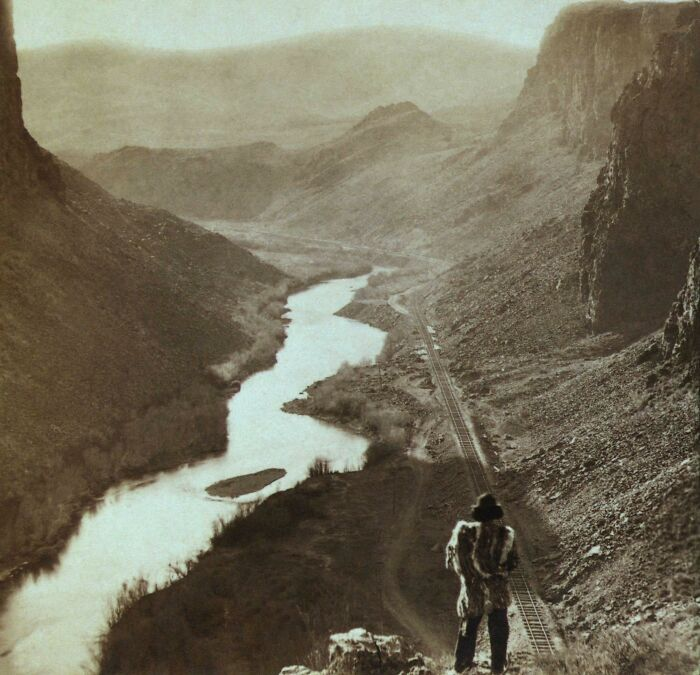A Native American Man Looking Over The Newly Completed Transcontinental Railroad In Nevada, 1869