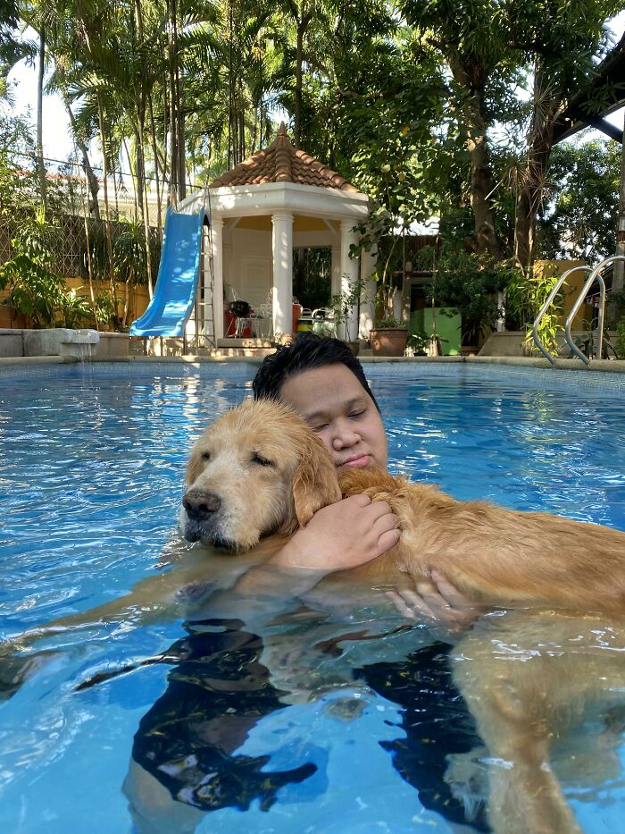 My Senior(Ish) Dog Can't Swim By Himself Anymore So I Carry Him While He Takes A Dip