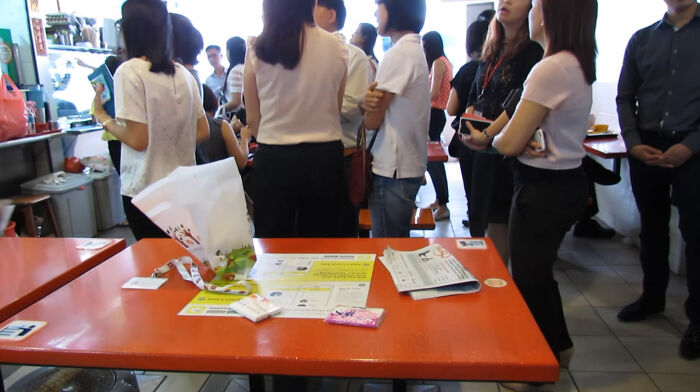 People In Singapore Reserve Seats In Public Eateries