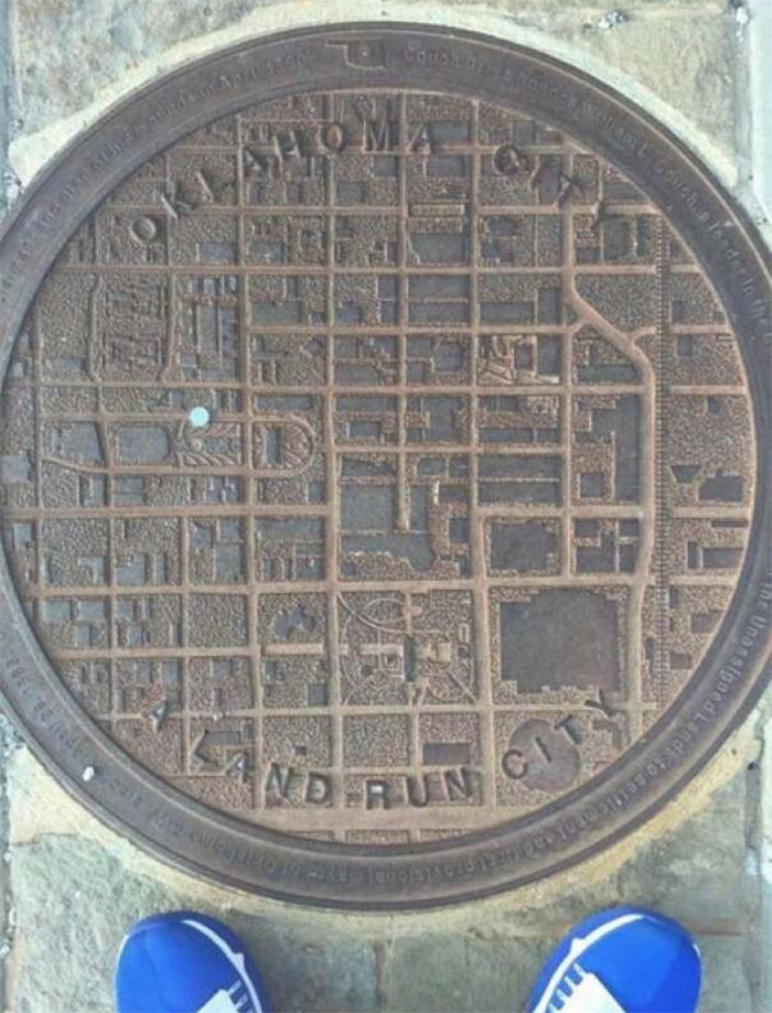 Oklahoma Man Hole Covers Have A City Map On, With A Blue Dot To Show Where You Are