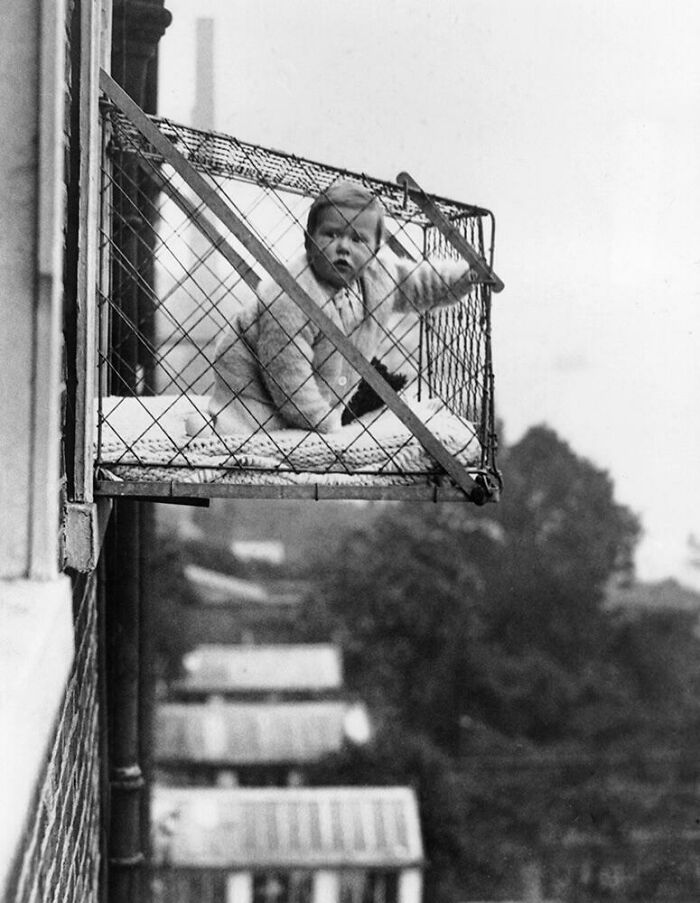 This 1930s Design Let You Hang Your Baby Over The Side Of A Building In A Cage