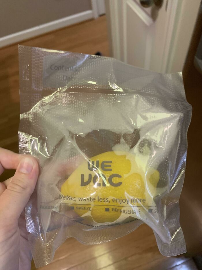"""A Packaged Lemon, With The Slogan """"Waste Less, Enjoy More"""""""