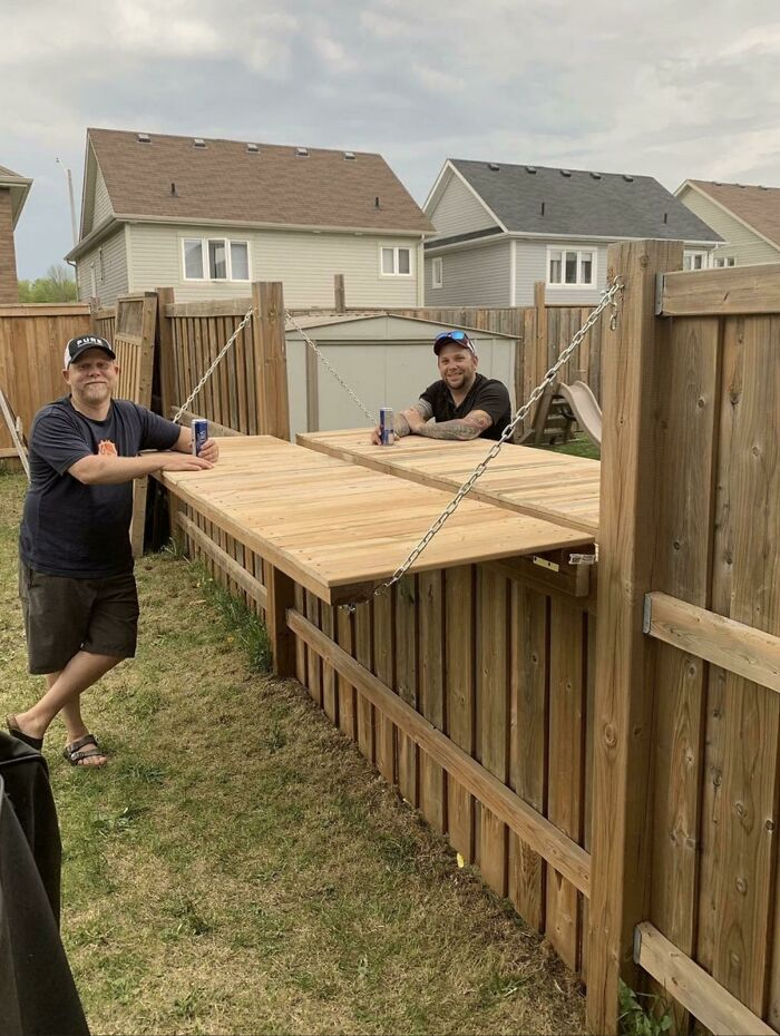These Neighbors Adjusted Their Fence So They Could Enjoy A Beer Together With Social Distance