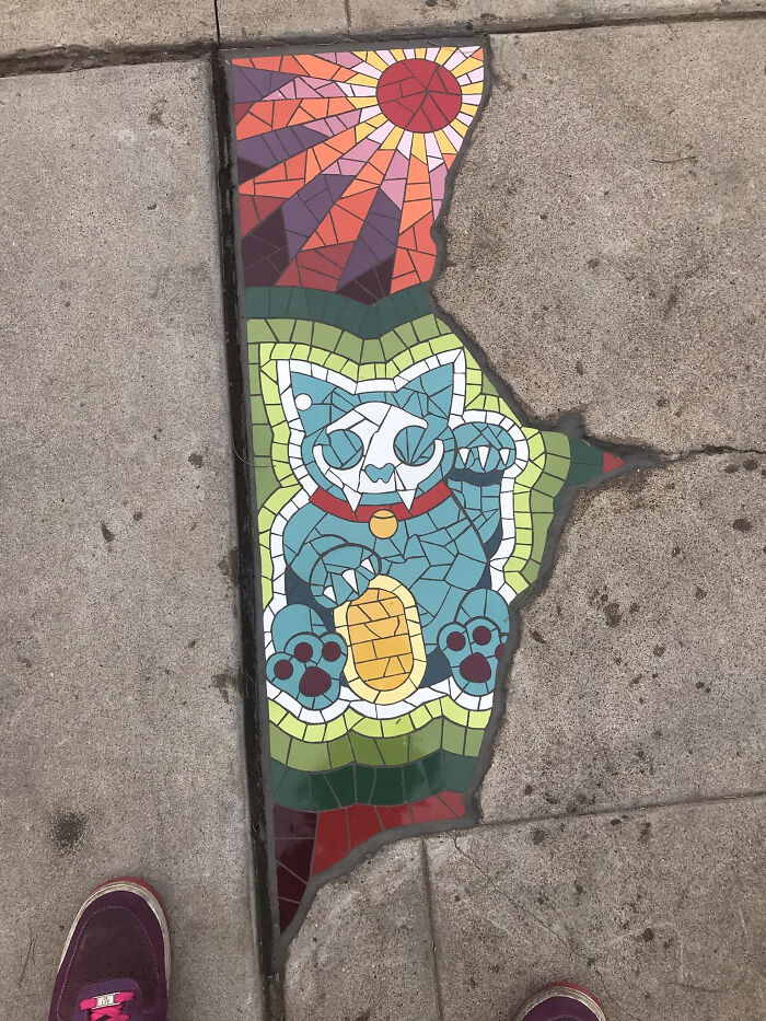 This Crack In The Pavement Filled With A Stained Glass Cat Portrait
